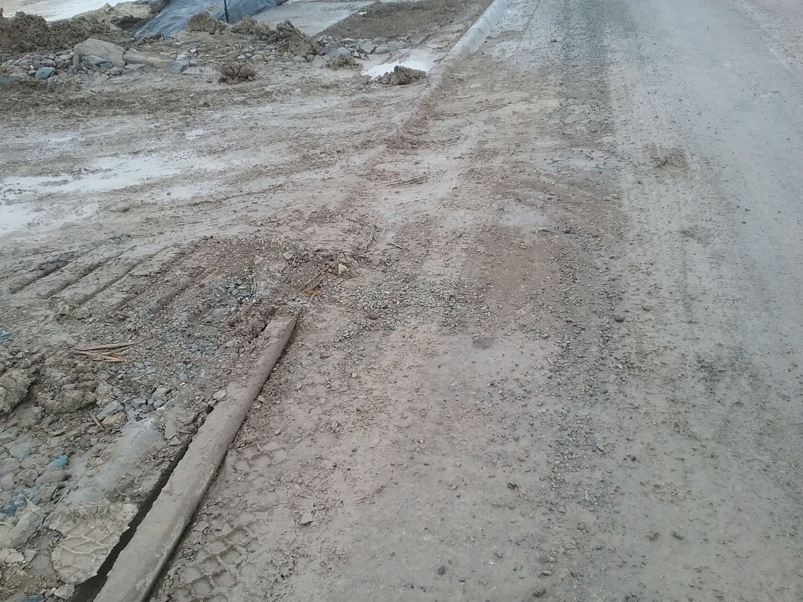 Sediment and rock being tracking into roadway at construction site