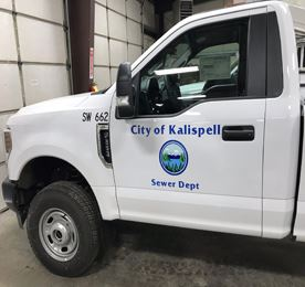 City vehicle with Sewer Dept. logo