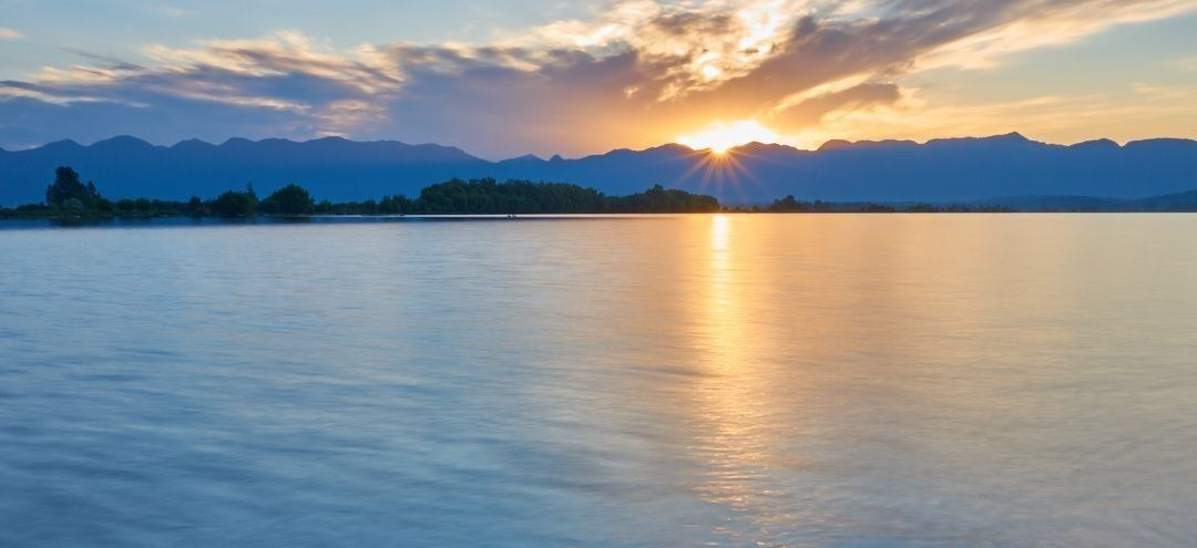 Sunset over lake with mountains