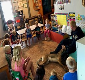Officer reading to children in a daycare