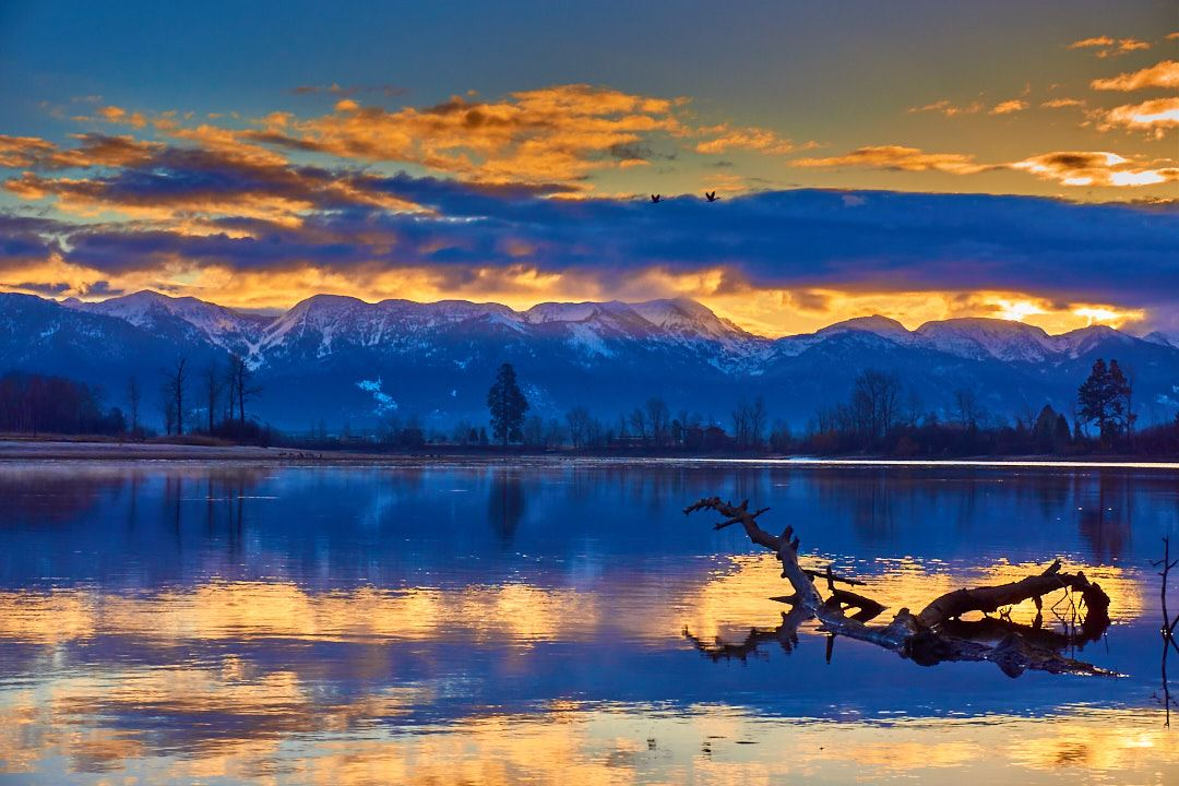 Sunrise over lake with mountains